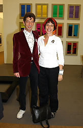 DOUGIE FIELD and LIZ O'SULLEVAN at a private view of the 2004 Frieze Art Fair - a major exhibition attended by most of the leading contempoary art dealers held in Regents Park, London on 14th October 2004.NON EXCLUSIVE - WORLD RIGHTS