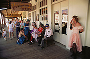 Tombstone, Arizona. Some of the actors who participate in hourly shoot outs mingle with tourists. USA.