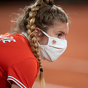 PARIS, FRANCE September 28.  A ball girl wearimng a mask awaits to retrieve the ball at the side of the net during the Petra Kvitova of the Czech Republic match against Oceane Dodin of France on Court Philippe-Chatrier in the first round of the singles competition during the French Open Tennis Tournament at Roland Garros on September 28th 2020 in Paris, France. (Photo by Tim Clayton/Corbis via Getty Images)