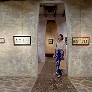 """Tucson, AZ -- 09/29/2017<br /> <br /> Tucson resident Jaclyn Moor walks through one of several rooms at the DeGrazia Gallery in the Sun in Tucson.<br /> <br /> <br /> DeGrazia Gallery in the Sun was designed and built by acclaimed Arizona artist Ettore """"Ted"""" DeGrazia. The gallery/museum was constructed in 1965 with details including cactus flooring, exposed wood beams, rafters and unique artistic finishes. <br /> <br /> Photography by Jill Richards"""
