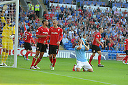 Man city's Alvaro Negredo  (on ground) reacts after missing a late chance for an equaliser. Barclays Premier league match, Cardiff city v Manchester city at the Cardiff city stadium in Cardiff, South Wales on Sunday 25th August 2013. pic by Andrew Orchard , Andrew Orchard sports photography,
