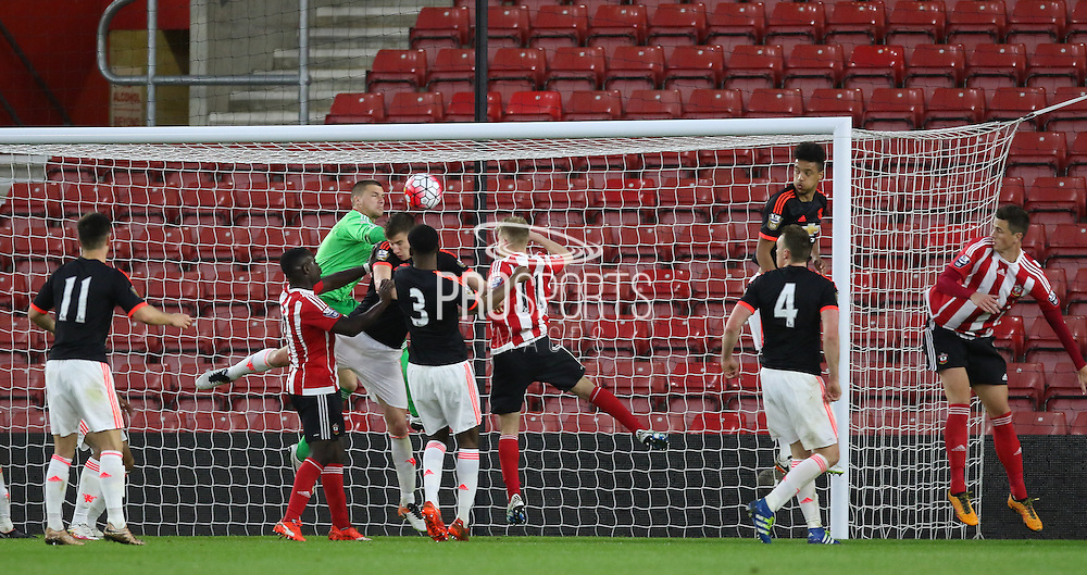 Manchester United Sam Johnstone can't stop Southampton Olufela Olomola headed goal during the Barclays U21 Premier League match between U21 Southampton and U21 Manchester United at the St Mary's Stadium, Southampton, England on 25 April 2016. Photo by Phil Duncan.