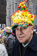 New York, NY, USA-27 March 2016. A man with a hat covers in marshamallow pees and bonbons in front of St. Patrick's Catherdral at the annual Easter Bonnet Parade and Festival