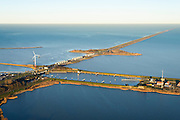 Nederland, Noord-Holland, Den Oever, 11-12-2013; begin Afsluitdijk met Stevinsluizen - spuisluizen, rechts de schutsluis. Waddenzee links in beeld.<br /> Beginning Enclosure Dam with Stevin Sluices and lock. Waddenzee (left).<br /> luchtfoto (toeslag op standaard tarieven);<br /> aerial photo (additional fee required);<br /> copyright foto/photo Siebe Swart.