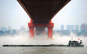 WUHAN, CHINA - NOVEMBER 23: <br /> <br /> A ship sails on the foggy Yangtze River on November 23, 2016 in Wuhan, Hubei Province of China. Fog rises from the surface of Yangtze River as the temperature in the air turns lower than the water\'s. <br /> ©Exclusivepix Media