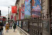 As museums and galleries are allowed to reopen, people pass the RA Royal Academy building along Piccadilly on 25th May 2021 in London, United Kingdom. As the coronavirus lockdown continues its process of easing restrictions, more and more people are coming to the West End as more businesses open.