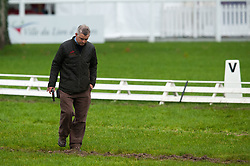 FEI Technical Delegate Alec Lochore (GBR) examines the condition of the dressage arena after heavy rain<br /> FEI World Championship for Young Horses Le Lion d'Angers 2012<br /> © Hippo Foto - Jon Stroud