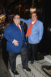 Left to right, BRIAN CLIVAZ and LAURENCE ISAACSON co-owners of L'Escargot at a Bastille Day Cocktail Party at L'Escargot, 48 Greek Street, London on 14th July 2014.