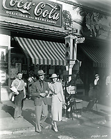 """1936 Robert Cummings and Marsha Hunt during the filming of """"Hollywood Boulevard"""" at Hollywood Blvd. & Vine St."""