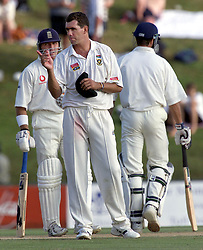 South African captain Hansie Cronje, with Alec Stewart (left) and Michael Vaughan, during the last day of the rain affected 5th Test at Centurion Park.