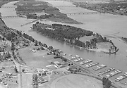 "ackroyd_05441-10. ""Aerials. August 1, 1954"" ""Jantzen Beach"" (and nearby Columbia River moorages, farmland)"
