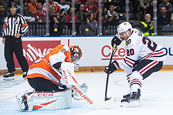 Brandon Saad of Chicago Blackhawks  and Carter Hart of Philadelphia Flyers   during NHL game between teams Chicago Blackhawks and Philadelphia Flyers at NHL Global Series in Prague, O2 arena on 4th of October 2019, Prague, Czech Republic. Photo by Grega Valancic / Sportida
