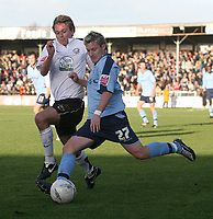 Photo:Mark Stephenson,Herford united v Port vale.<br />fa cup 2-11-2006.Vales Ross Gardner on the attack with Herefords Luck Webb.