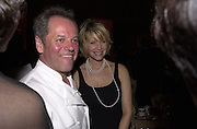 Wolfgang Puck and Kate Capshaw. Post Oscars, Governor's Ball. Los Angeles. 25 March 2001. © Copyright Photograph by Dafydd Jones 66 Stockwell Park Rd. London SW9 0DA Tel 020 7733 0108 www.dafjones.com