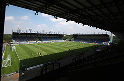 A general view of warming up during a pre season friendly match at The Kassam Stadium, Oxford.