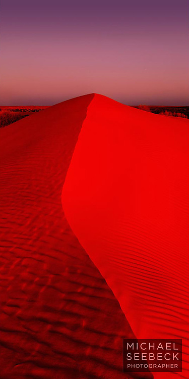 """""""Big Red"""" sand dune, supposedly the largest sand dune in the Simpson Desert, captured in the sunset glow at dusk.<br /> <br /> Limited Edition Print"""