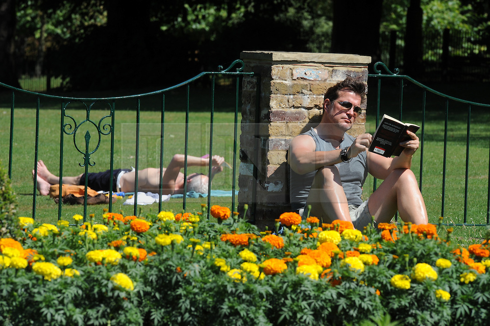 © Licensed to London News Pictures. 01/08/2013<br /> The hottest August in Ten years.<br /> People enjoying the hot start to August today (01.08.2013) in the Priory Gardens,Orpington, Kent.<br /> Photo credit :Grant Falvey/LNP