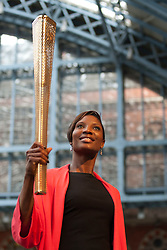© licensed to London News Pictures. LONDON, UK  08/06/11. Athlete Denise Lewis holds up a prototype Olympic torch ahead of the 2012 London Olympics the prototype Olympic torch is unveiled at St Pancras Station, London. Please see special instructions for usage rates. Photo credit should read Matt Cetti-Roberts/LNP