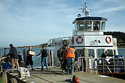 Unloading supplies from the ferry boat Island of Herm, Channel Islands, Great Britain
