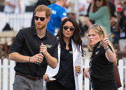 The Duke and Duchess of Sussex with the Duchess's Private Assistant Secretary Amy Pickerill (right) at the Invictus Games Jaguar Land Rover Driving Challenge, on Cockatoo Island, Sydney, on the fifth day of the royal couple's visit to Australia.