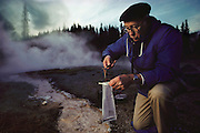 (1992) Microbiologist, Tom Brock at Octopus Spring and White Creek (Great Fountain Area) where he found the bacteria Thermus Aquaticus (TAQ 1), which is used in a process to amplify DNA called polymerase chain reaction (PCR). His discovery made automated PCR possible.  Here he was studying the out-flow channels of boiling hot springs. DNA Fingerprinting. MODEL RELEASED