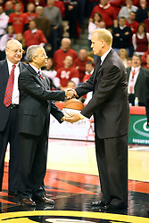03 February 2007: Doug Collins shakes hands and accepts a token basketball from Illinois State University President Al Bowman as the playing service in Redbird Arena is dedicated as Doug Collins Court. In what is locally referred to as the War on Seventy Four, the Bradley Braves defeated the Illinois State University Redbirds 70-62 on Doug Collins Court inside Redbird Arena in Normal Illinois.
