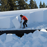 Jeff Henry, winter keeper in Yellowstone National Park, clears snow from the roof of the Canyon Store. Wyoming