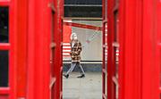 23rd February, Cheltenham, England. A shopper walks up the promenade area of Cheltenham wearing a mask.