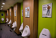 Toilets with ads for flatulence filters on M56 motorway service station, 21st April 2021 near Blackpool, Lancashire, United Kingdom.