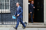Britain's Foreign Secretary Dominic Raab leaves Downing Street after a Cobra meeting in London, Wednesday, March 18, 2020. For most people, the new coronavirus causes only mild or moderate symptoms, such as fever and cough. For some, especially older adults and people with existing health problems, it can cause more severe illness, including pneumonia.(Photo/Vudi Xhymshiti)