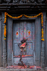 Temple doors on a walk through Nuwakot on Motorcycle Sherpa's Ride to the Heavens motorcycle adventure in the Himalayas of Nepal. This first day of riding took us from Kathmandu to Nuwakot. Monday, November 4, 2019. Photography ©2019 Michael Lichter.