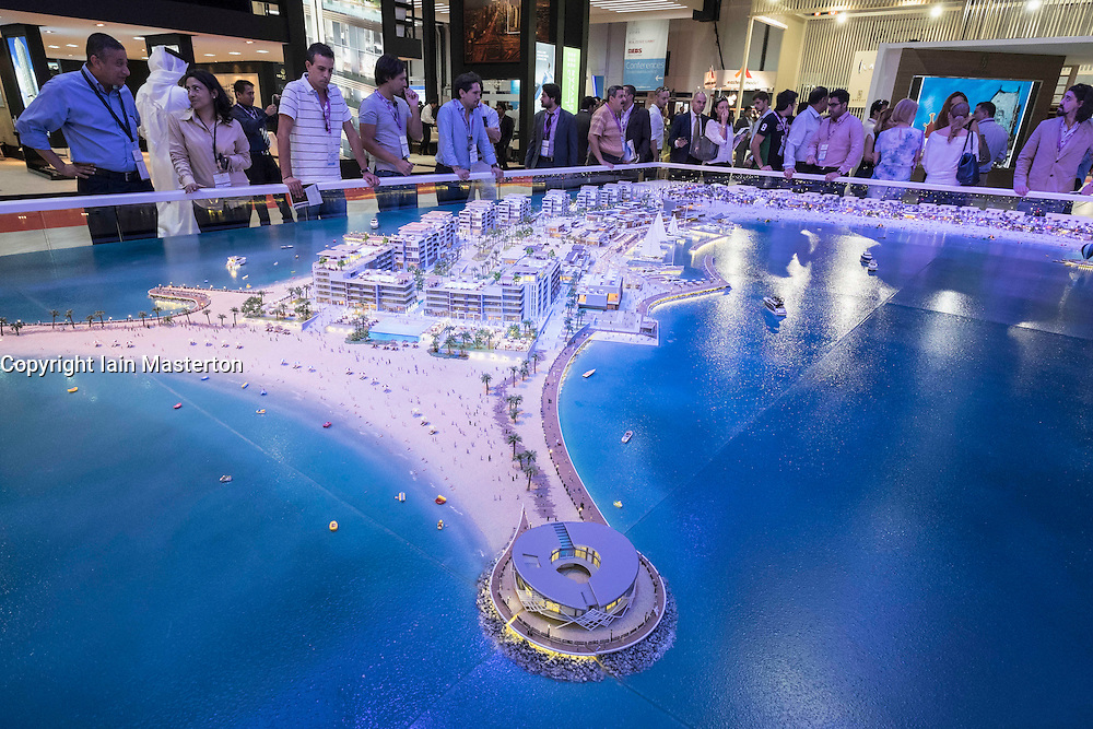 Model of new luxury property development La Mer in Dubai by developer Meraas at property trade fair in Dubai United Arab Emirates