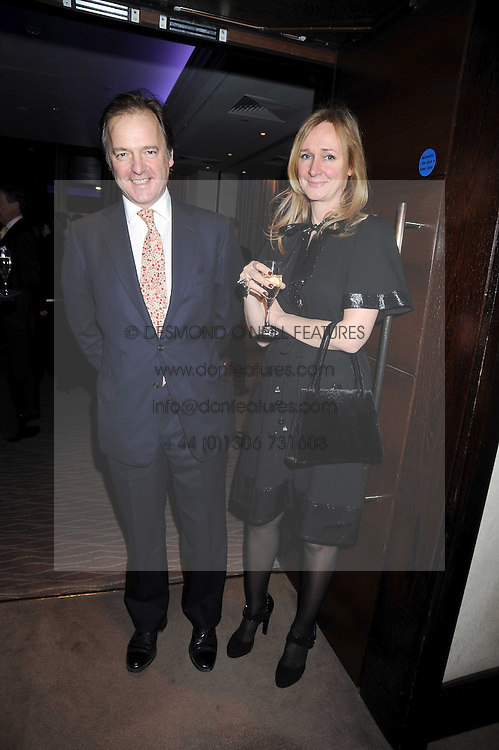 HUGO SWIRE MP and his wife SASHA at the Palace of Varieties in aid of Macmillan Cancer Support held at the InterContinental Hotel, Park Lane, London on 5th February 2009.