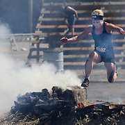 Amy Cardillo in action at the fire jump obstacle during the Reebok Spartan Race. Mohegan Sun, Uncasville, Connecticut, USA. 28th June 2014. Photo Tim Clayton