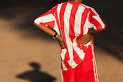 Young football player in red and white stripes and shadow, Bagan