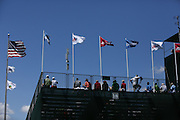 June 12 2013: Flags of the USA and USGA fly on top of the grandstand on 18 during the wednesday practice round at the 2013 U.S. Open hosted by Merion Golf Club in Ardmore, PA.