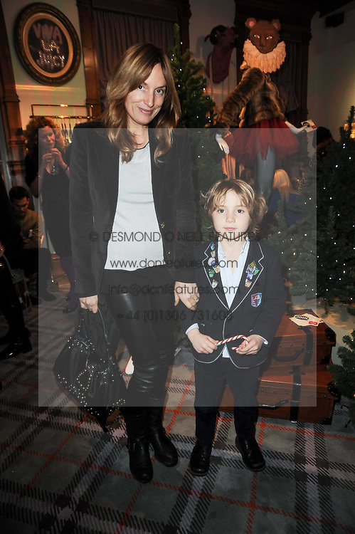 EMILY OPPENHEIMER-TURNER and her son THEO at the Juicy Couture children's tea party in aid of Mothers 4 Children held at the Juicy Couture Store, Bruton Street, London on2nd December 2009.
