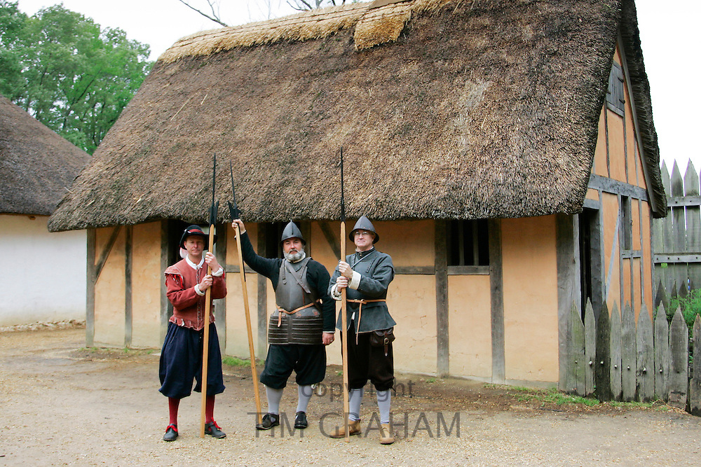 Costume characters at replica colonial fort heritage tourist attraction at Jamestown, Williamsburg, Virginia, USA