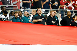 18 Jan 2009: Philadelphia Eagles Head Coach Andy Reid during the National Anthem with the American Flag in the foreground before the NFC Championship game against the Arizona Cardinals on January 18th, 2009. The Cardinals won 32-25 at University of Phoenix Stadium in Glendale, Arizona. (Photo by Brian Garfinkel)