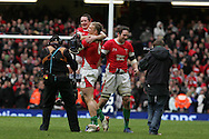 The final whistle goes and Welsh match winner Shane Williams  is lifted by Andy Powell. RBS Six nations, Wales v Scotland at the Millennium stadium, Cardiff on Sat 13th Feb 2010. pic by  Andrew Orchard sports photography,