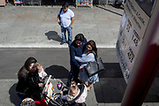As a mum and her young children walk past, a heavily pregnant mother-to-be with her doting partner stands at the bus stop opposite St. Thomas's Hospital, on 5th June 2019, in London, England.