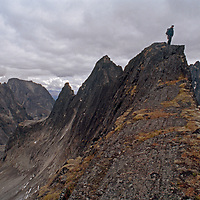 A Mountaineer stands atop a high ridge in the Cirque of the Unclimbables in Canada's Logan Mountains.