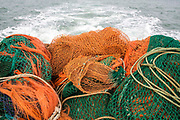 Fishing nets on the back of a boat as it leaves Dover harbour, ready for a night out trawler fishing in the English channel. United Kingdom.