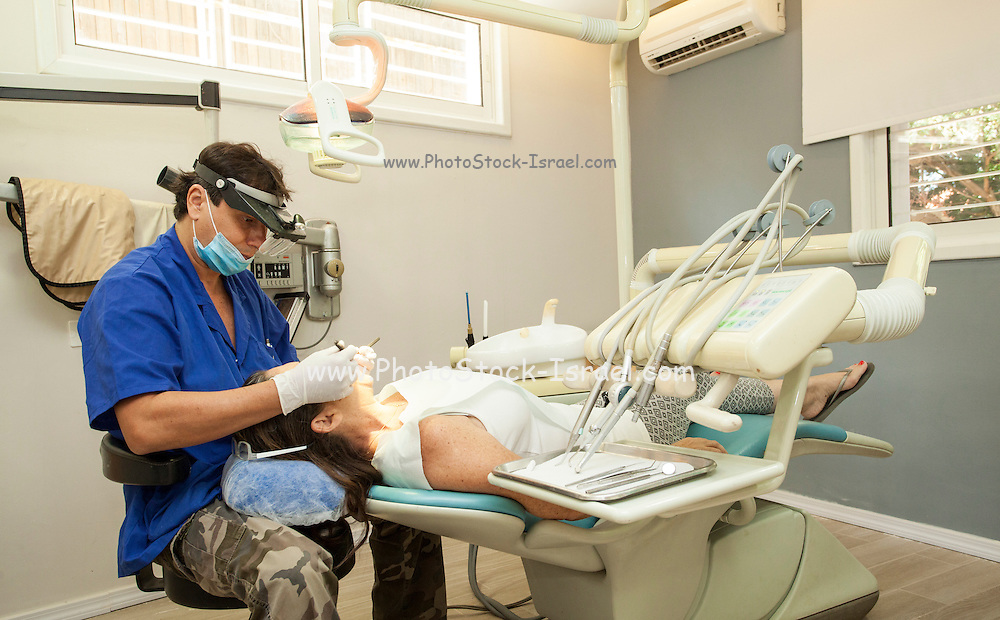Female patient treated by a dentist Model released
