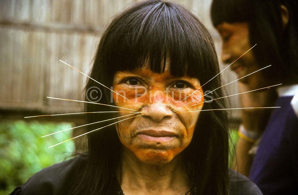 """A """"Matses"""" tribal women with facial decorations in the form of cats whiskers  made from thin bamboo sticks, Remoyacu village, Peru"""