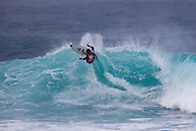 Eli Hanneman of Hawaii advances in 1st to round 2 from round 1 heat 2 of the Volcom Pipe Pro held at Pipeline, Oahu, Hawaii.