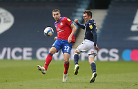 Blackburn Rovers' Taylor Harwood-Bellis and Millwall's Jed Wallace<br /> <br /> Photographer Rob Newell/CameraSport<br /> <br /> The EFL Sky Bet Championship - Millwall v Blackburn Rovers  - Saturday 6th March 2021 - The Den - London <br /> <br /> World Copyright © 2021 CameraSport. All rights reserved. 43 Linden Ave. Countesthorpe. Leicester. England. LE8 5PG - Tel: +44 (0) 116 277 4147 - admin@camerasport.com - www.camerasport.com