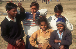 Group of young boys standing together laughing and joking,