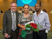 Mark White, left, and Gwendolyn Johnson, center, pose for a photograph during the Board of Education meeting, October 9, 2014.