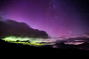 Looking North along the Bunnahabhain Road showing the Paps of Jura and the Aurora Borealis